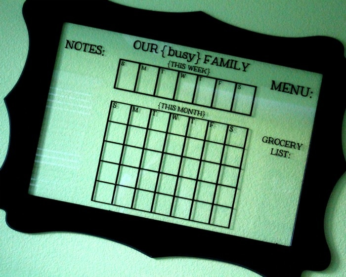 Glass dry erase calendar, a cute way for any busy family to get organized! { lilluna.com }