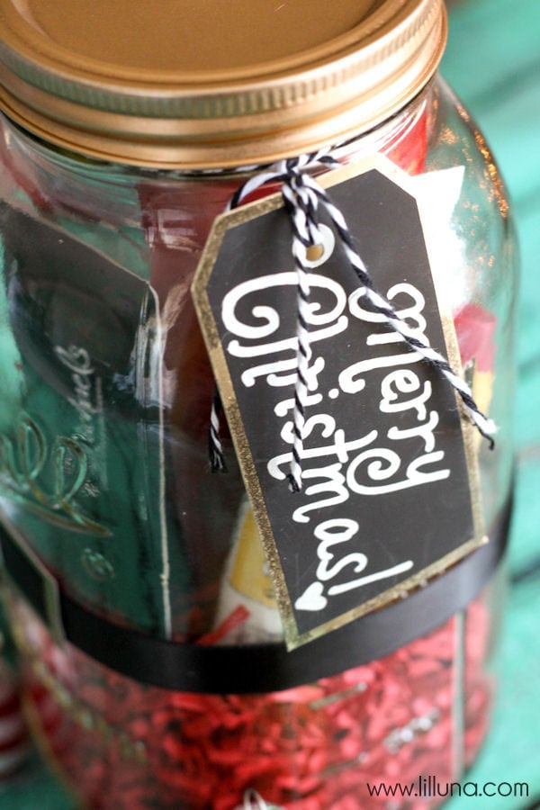 Super Cute and Simple Santa Jar Gift filled with favorite things - tutorial on { lilluna.com } Grab a jar, scrapbook paper, ribbon, grass paper and you're ready to fill!