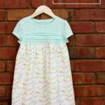 Simple and Sweet T-Shirt Dress Tutorial - check it out to learn how to turn any shirt into an adorable dress!! { lilluna.com } All you need is a t-shirt and fabric!!