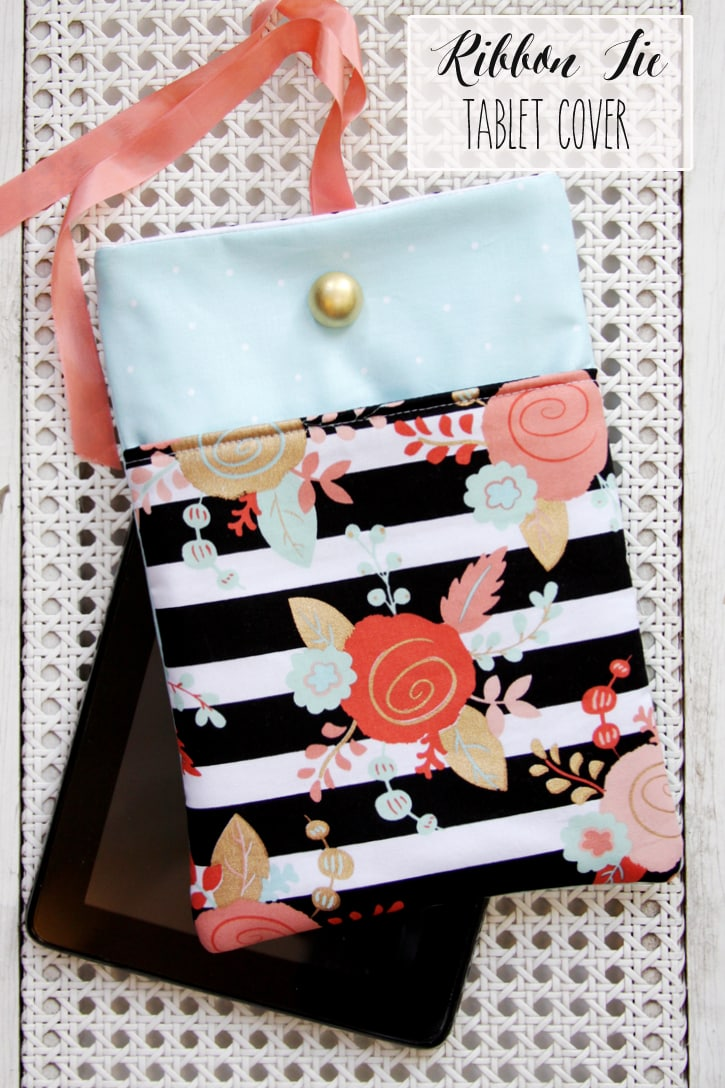 DIY Ribbon Tie Tablet Cover - SO CUTE!! It's the perfect gift idea for the friend or family member who can't live without their tablet. All you need is some cute fabric, fusible fleece, a button, ribbon, and some basic sewing supplies!