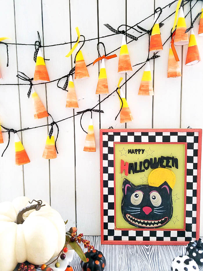 ADORABLE Candy Corn Banner made out of paper plates and paint - such a fun, cute and inexpensive Halloween craft.